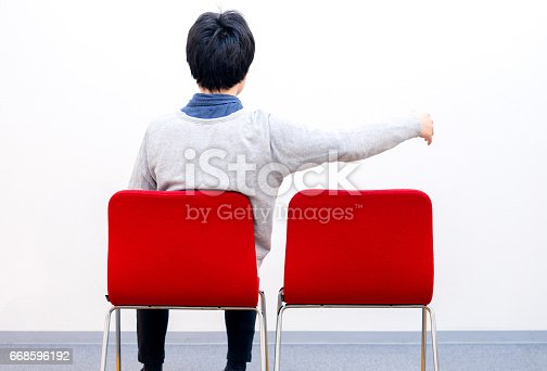 1125634038 istock photo Man sitting alone 668596192