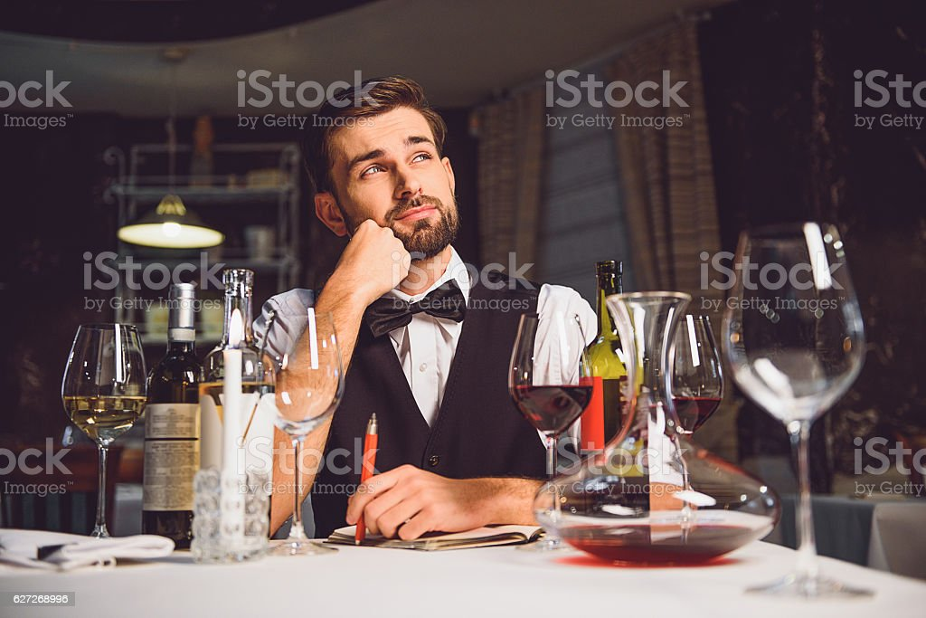 Man sitting and absorbedly thinking stock photo