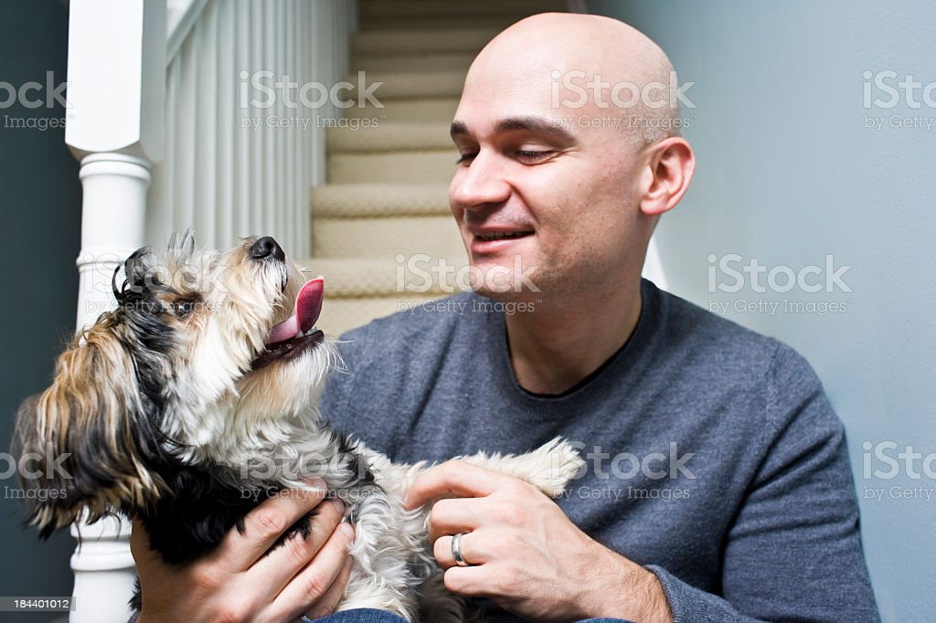 Man sitting and playing with his Dog royalty-free stock photo