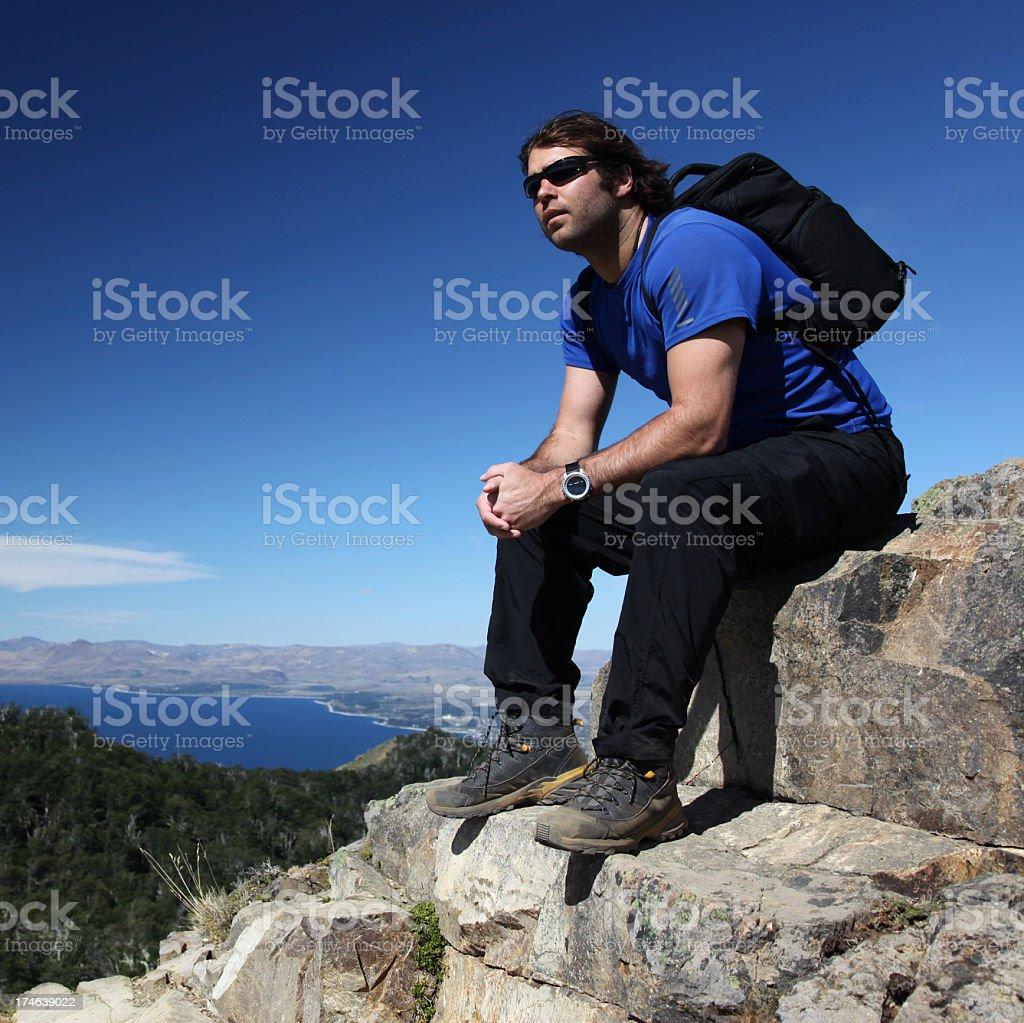 Man Sitting and Thinking on Mountain Summit royalty-free stock photo