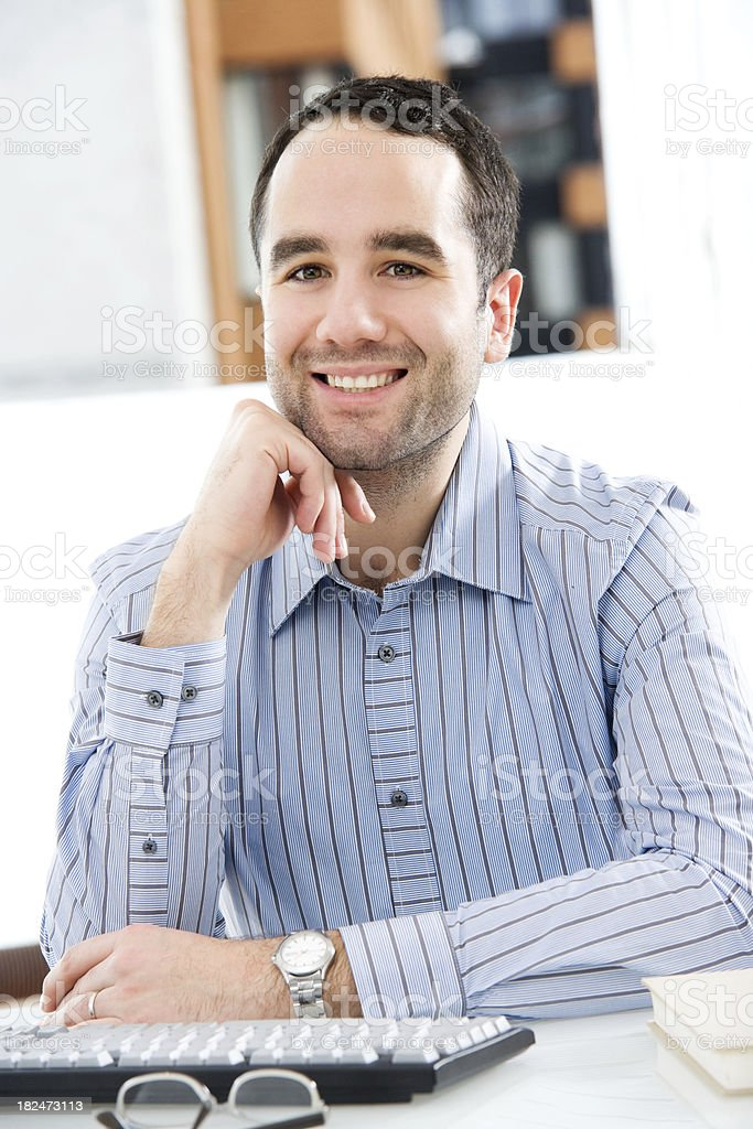 Man Sitting at a Desk Typing royalty-free stock photo