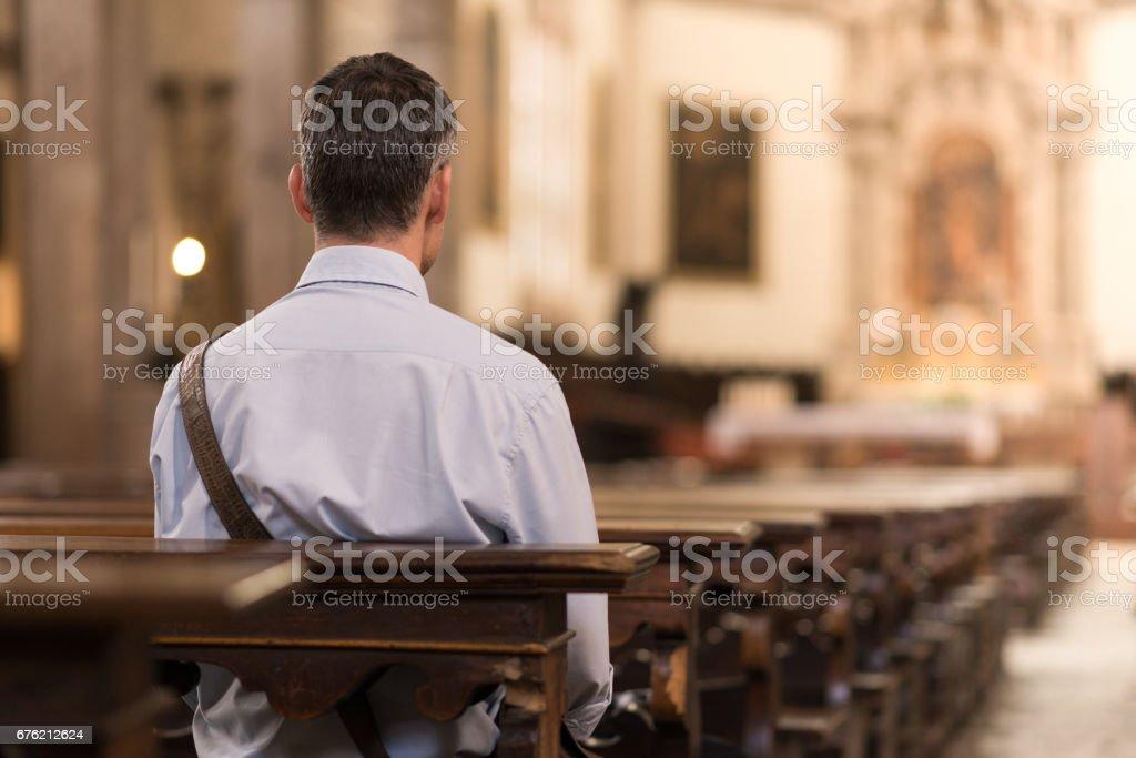 Man sitting at Church stock photo