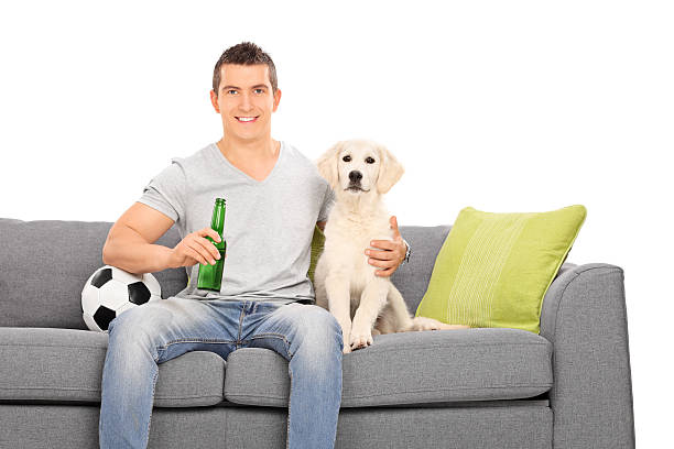 Man sitting at couch with his puppy and football picture id511849443?b=1&k=6&m=511849443&s=612x612&w=0&h=whb8j0w89aght2um2fq gosuspifk wln2mkn2uh0ru=