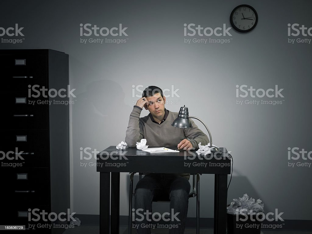 Man sitting at Desk Experiencing Writers Block royalty-free stock photo