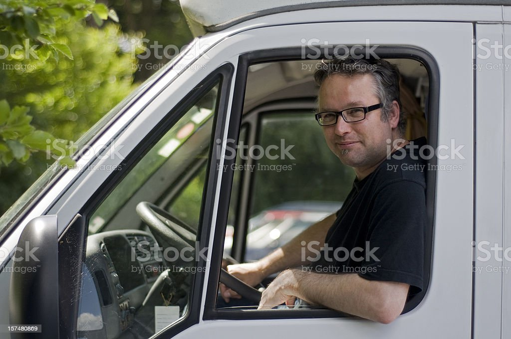 Man sitting at open window and steering wheel van royalty-free stock photo