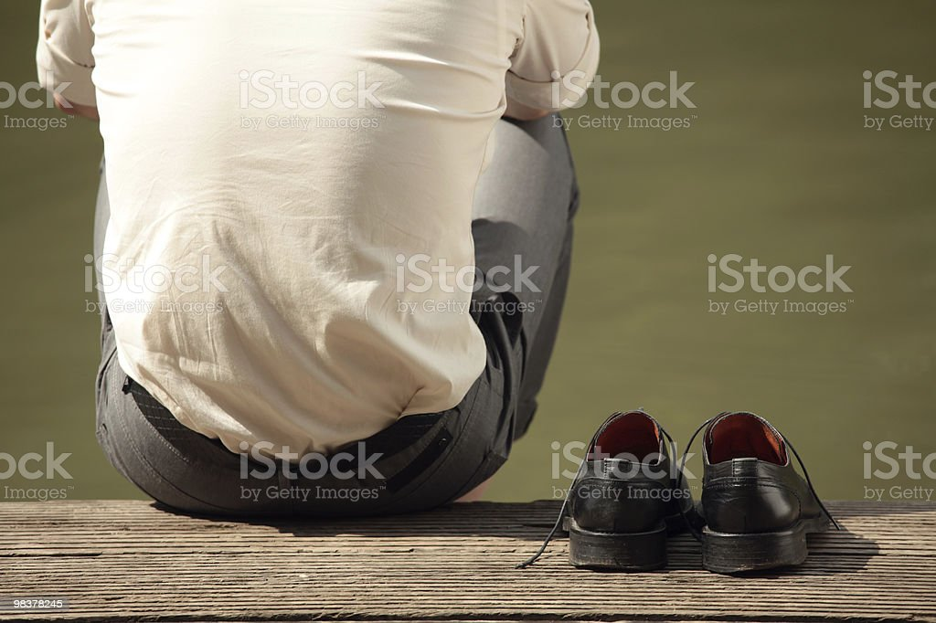 man sitting at the pier royalty-free stock photo