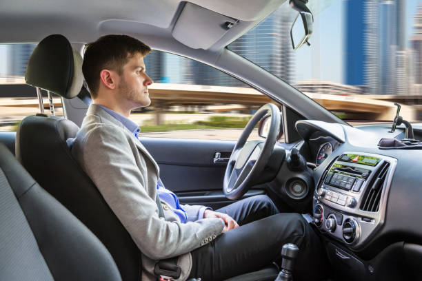 man sitting autonomous car - self driving car stock photos and pictures