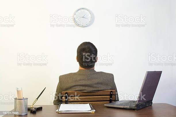 Man sitting backing against a desk looking up at a clock picture id157317593?b=1&k=6&m=157317593&s=612x612&h=3ol dnz7xft o19 1o5q r0u06i46aaambx yhcqfl0=