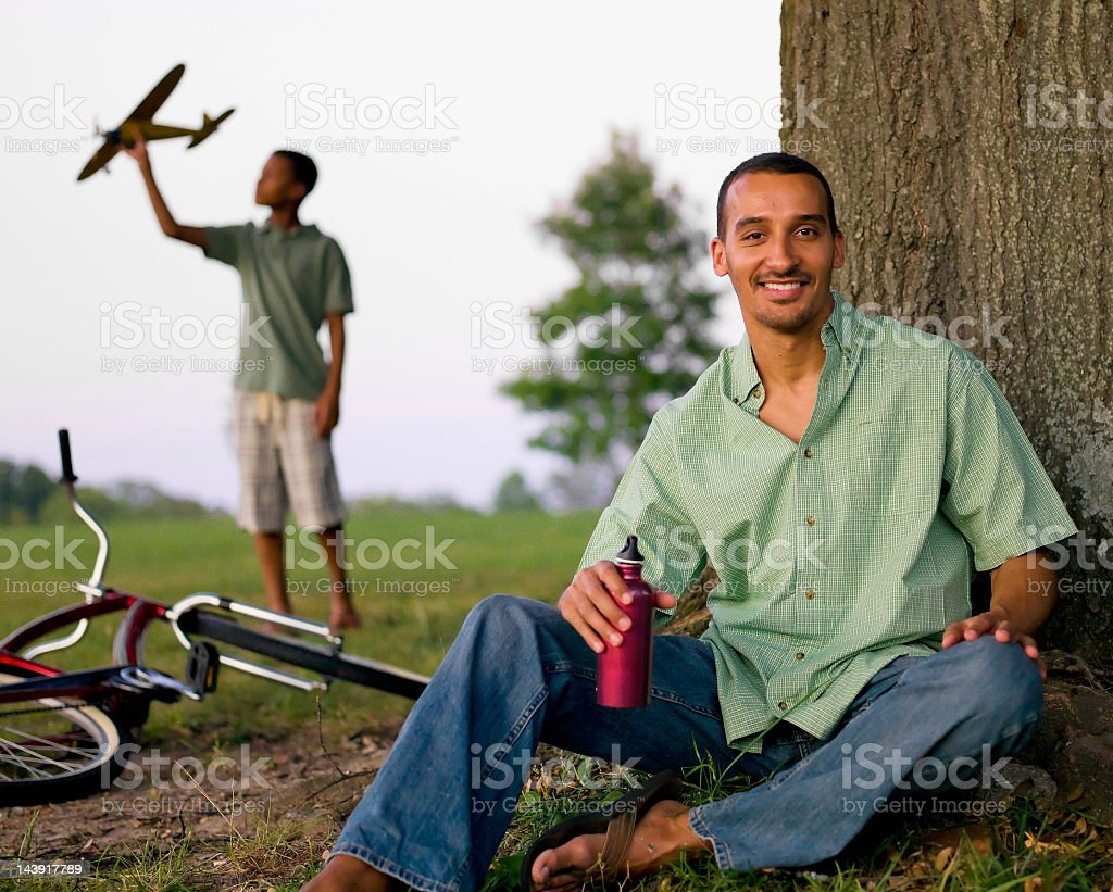 Man sitting by tree. royalty-free stock photo