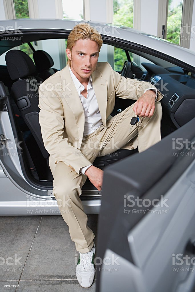 Man sitting in a sports car stock photo