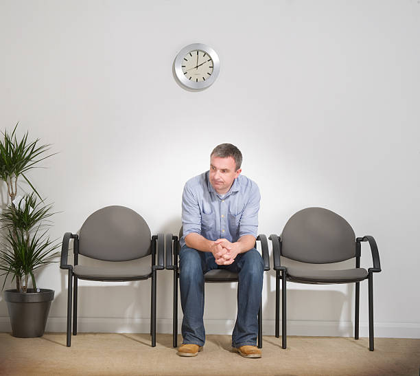 Man Sitting in a Waiting Room stock photo
