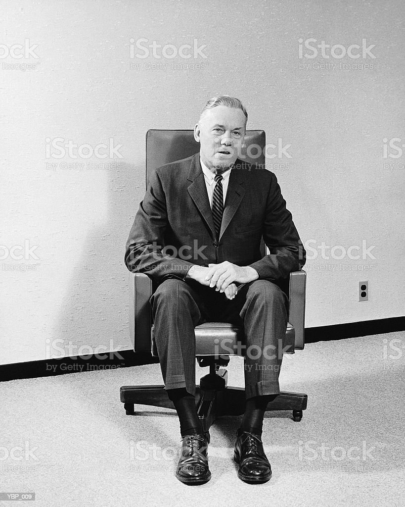 Man sitting in chair royalty-free stock photo