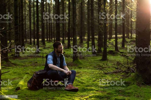 Photo of Man sitting in forest