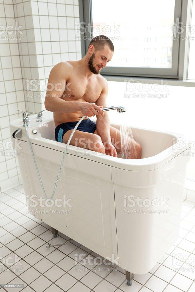 Man Sitting In Hydromassage Tub stock photo