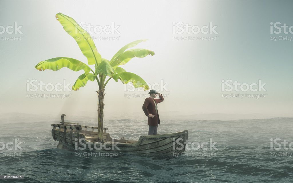 Man sitting in old wooden boat stock photo