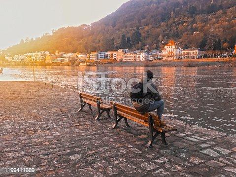 man sitting in sea side