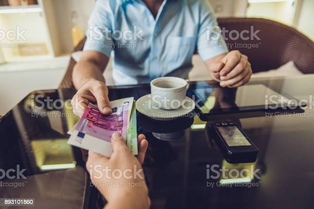 Man sitting in the cafe gives money to another man picture id893101860?b=1&k=6&m=893101860&s=612x612&h=dglfb zkcpjp4sfsuxhynn1px2rinxugbr rlwu 6qc=