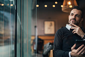 Man sitting in the caffee shop and using phone