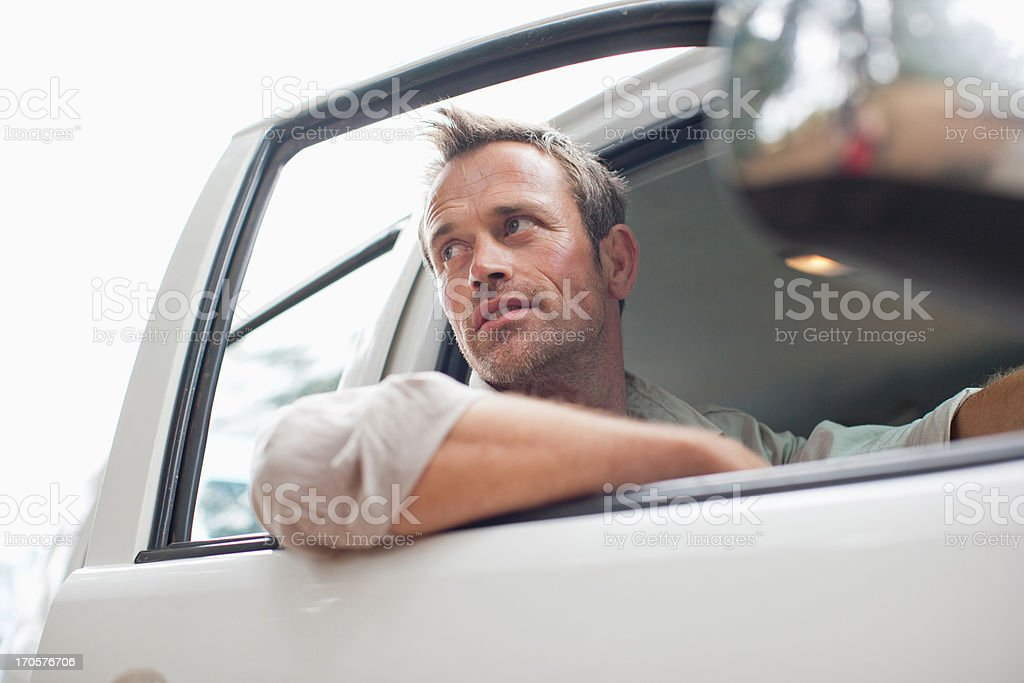 Man sitting in truck cab royalty-free stock photo