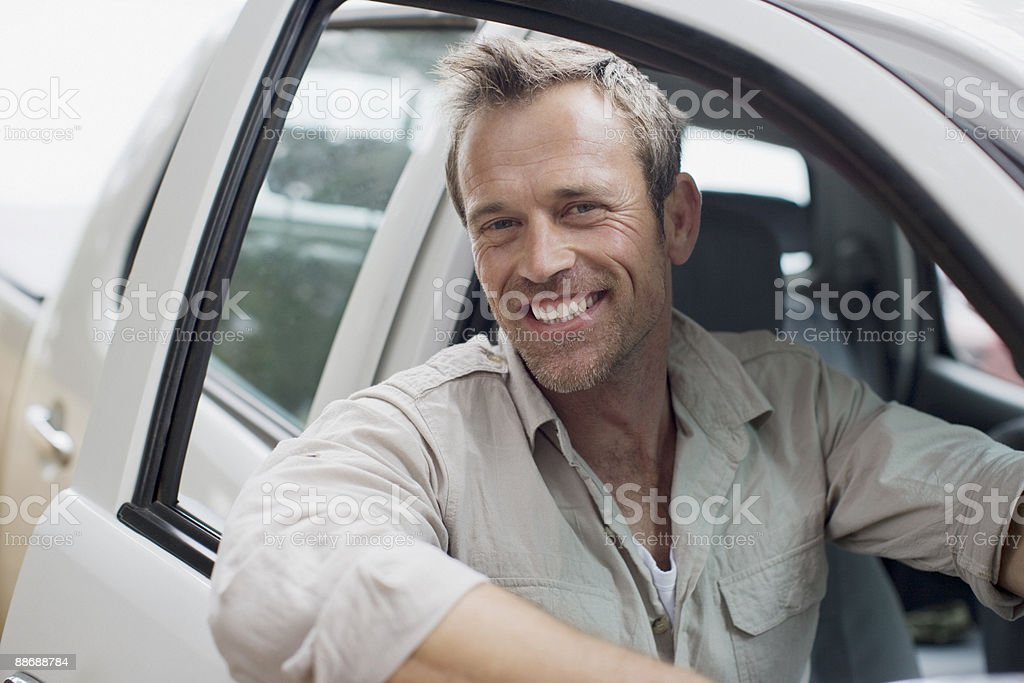 Man sitting in truck cab 免版稅 stock photo