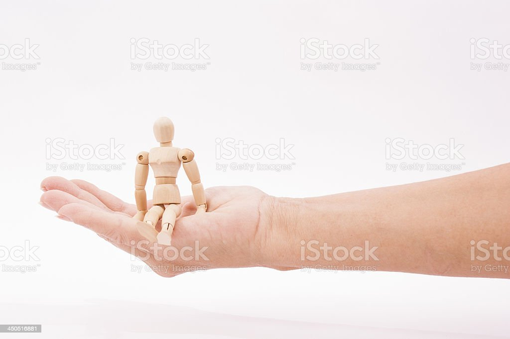 man sitting in woman's palm Clipping path stock photo