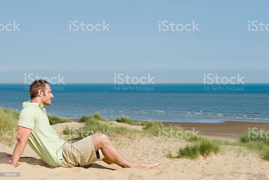 Man sitting on a beach 免版稅 stock photo