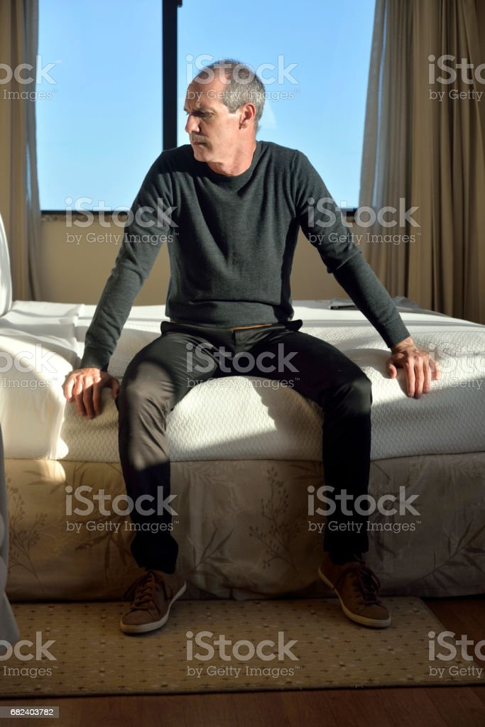 Man sitting on a bed royalty-free stock photo
