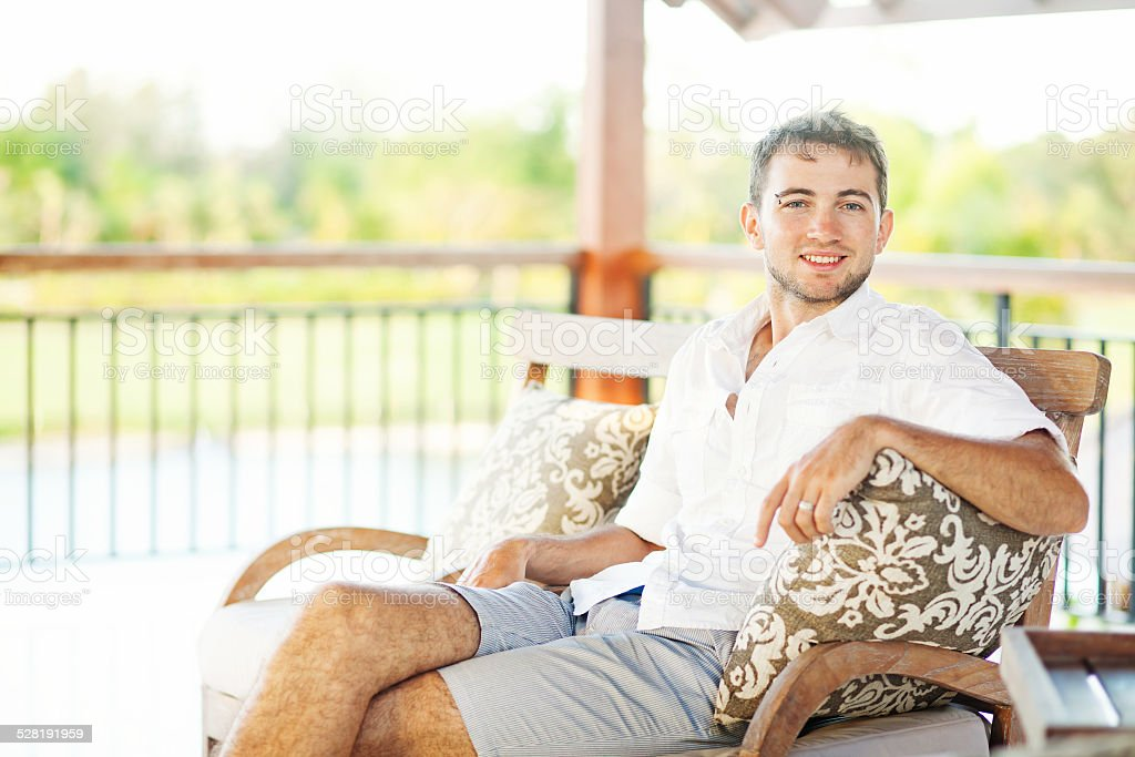 Man sitting on a bench stock photo