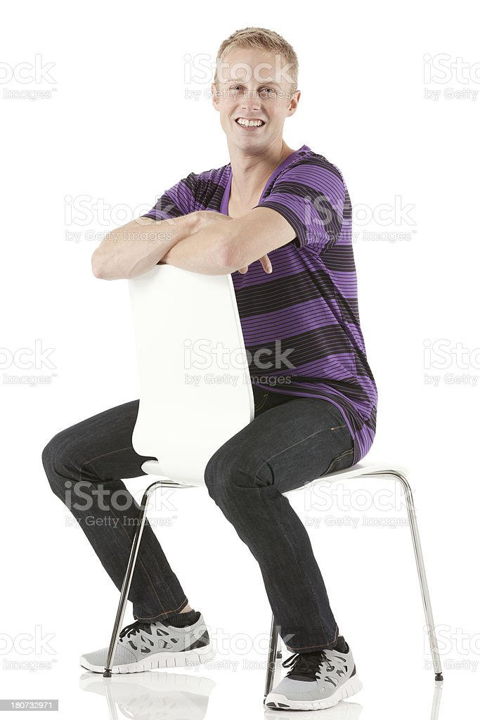 Man sitting on a chair back to front royalty-free stock photo