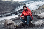 man sitting on a glacier in iceland