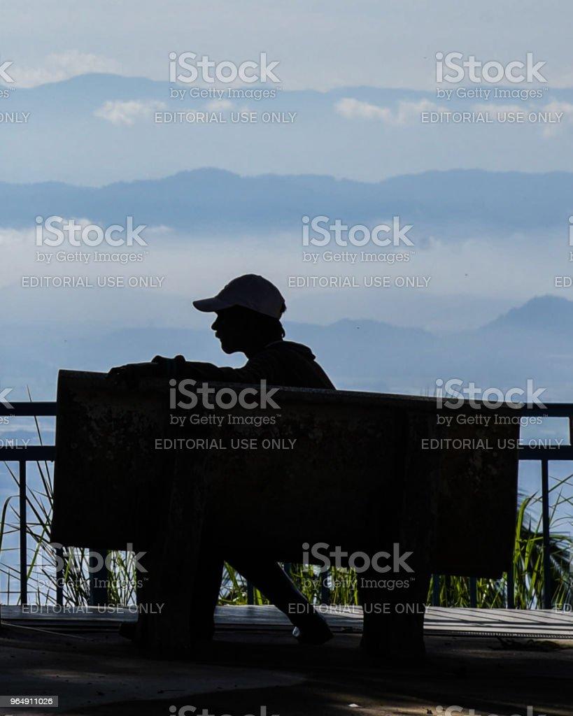 Man sitting on bench at Penang Hill royalty-free stock photo