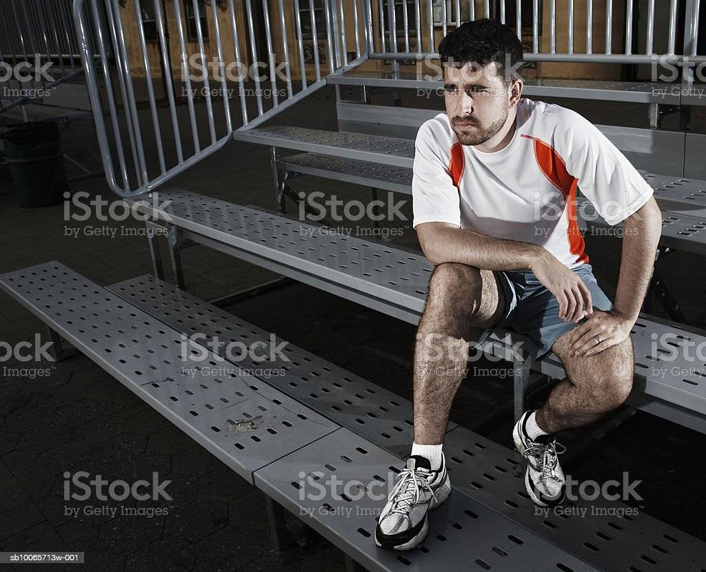 Man sitting on bleachers royalty-free stock photo