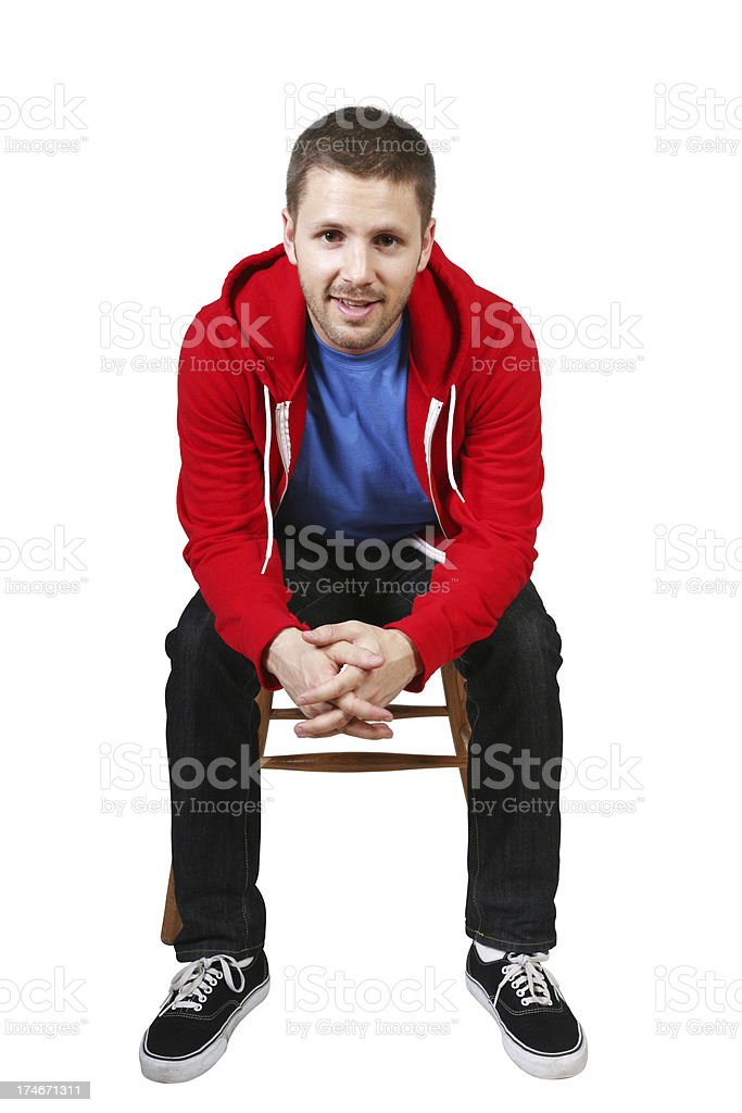 Man sitting on chair leaning forward royalty-free stock photo