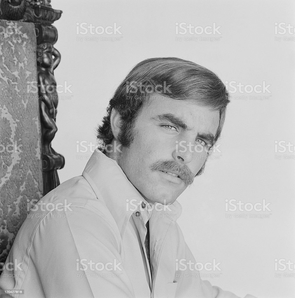 Man sitting on chair, portrait stock photo