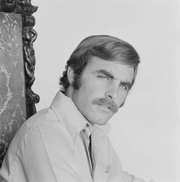 Man sitting on chair, portrait stock photo