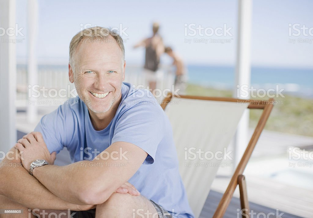 Man sitting on deck smiling royalty-free stock photo
