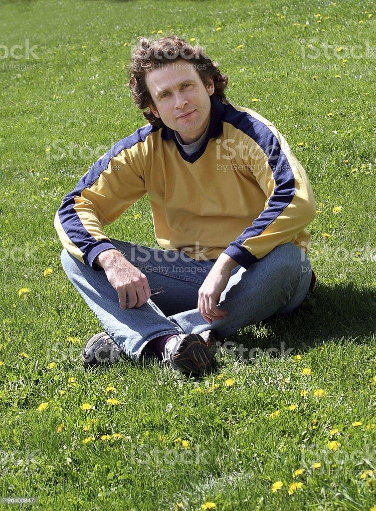 Man sitting on grass royalty-free stock photo