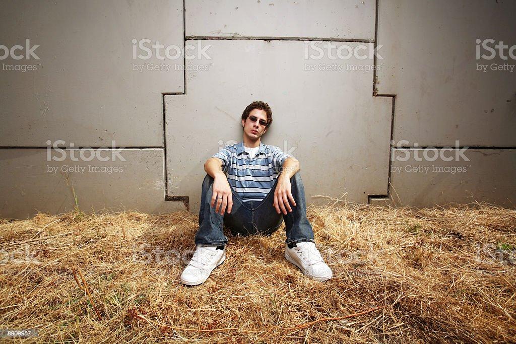 Man Sitting on Hay Portrait royalty-free stock photo