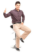istock Man sitting on high chair and giving thumb up 177010420