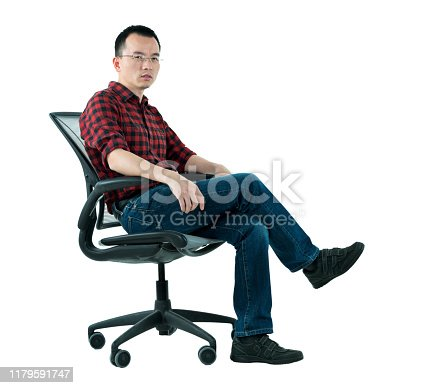 istock Man sitting on office chair 1179591747