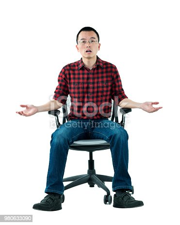 istock Man sitting on office chair with arms outstretched 980633090