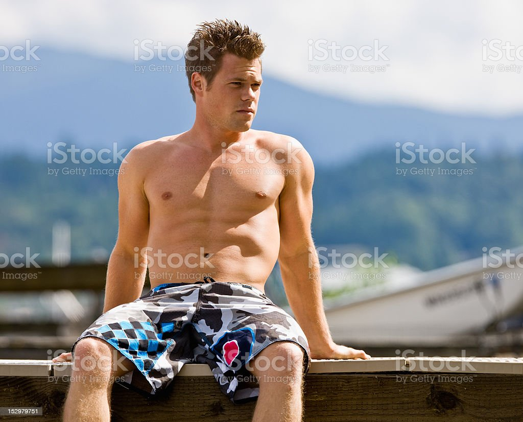 Man sitting on pier royalty-free stock photo
