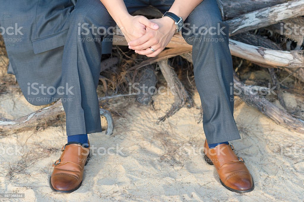 man sitting on roots royalty-free stock photo