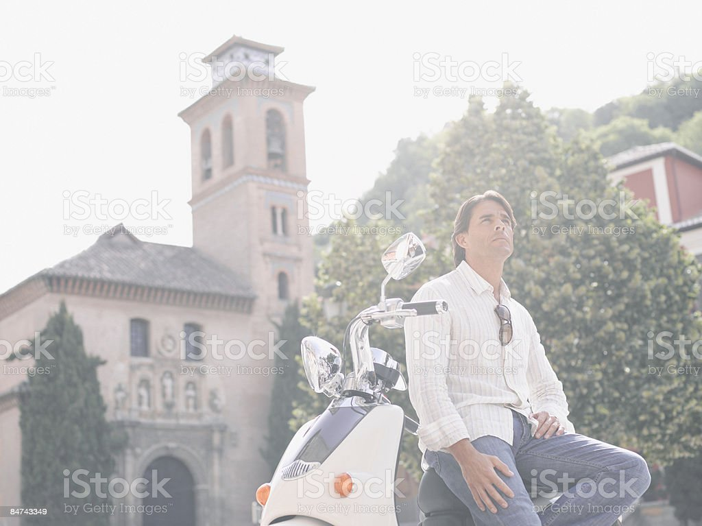 Man sitting on scooter royalty-free stock photo