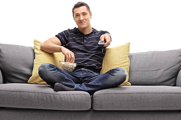 Best Silhouette Of Man Sitting On Couch Stock Photos