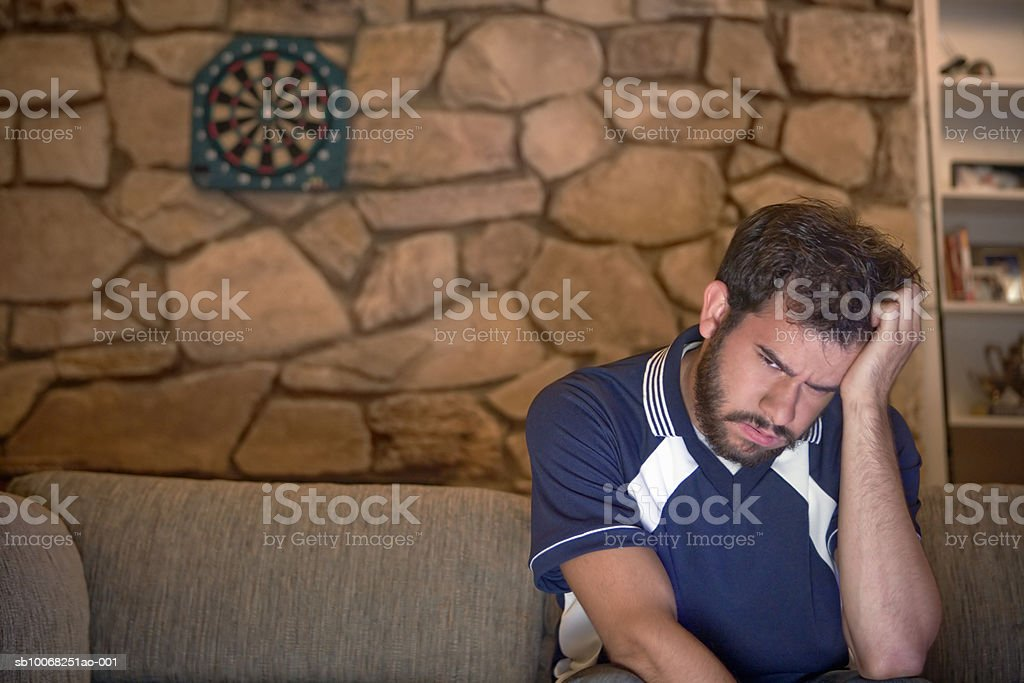 Man sitting on sofa royalty-free stock photo