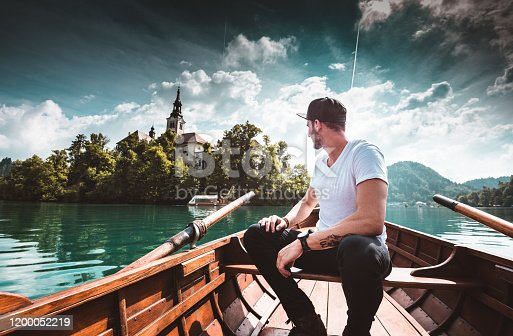 man sitting on the boat in Bled