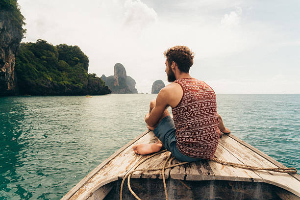 Man sitting on the boat stock photo