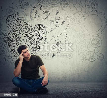 istock Man sitting on the floor hard thinking, find a solution to solve problem. Different imagination, alternative idea. Gear brain arrows and mess as thoughts. 1153091036