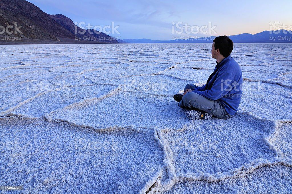 Man sitting on the ground, Badwater, Death Valley, California, USA royalty-free stock photo